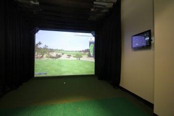 Club Metro Jersey City Gym, Jersey City, NJ golf room virtual driving range