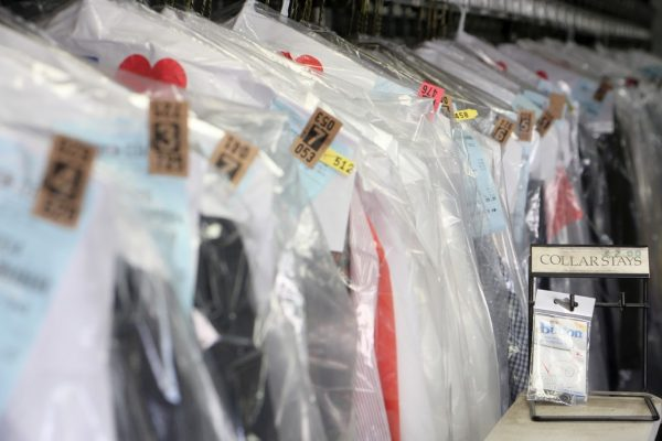 dry cleaning rack at counter at Kingston Cleaners Cherry Hill NJ.jpg