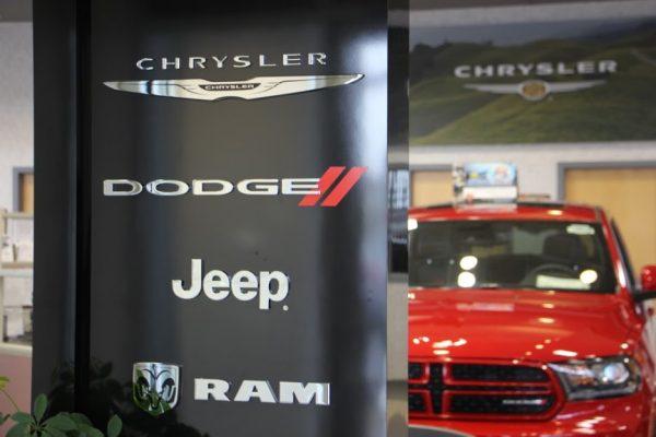 Carman Chrysler Dodge Jeep Ram New Castle DE automobile car dealership company logos red truck