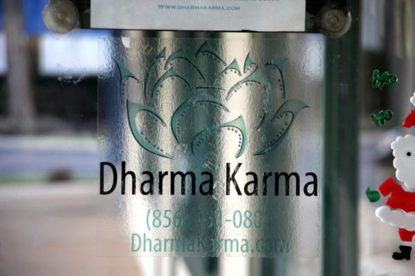 Dharma Karma Cherry Hill NJ logo sign lotus