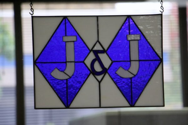 J & J Staffing Resources Swedesboro NJ stained glass company logo