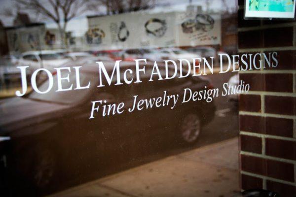 Joel McFadden Designs Red Bank NJ ring maker jewelery designer window logo sign