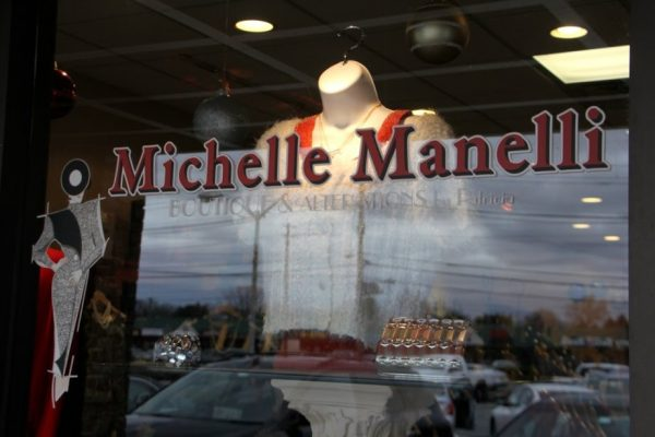 Michelle's Manelli Cherry Hill NJ boutique shop store front window display logo sign