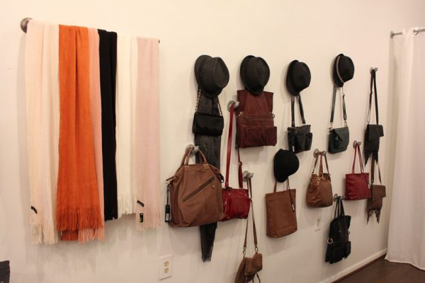 Six-on-East-Haddonfield-NJ-hanging-scarves-bags-purses-hats-wall-display