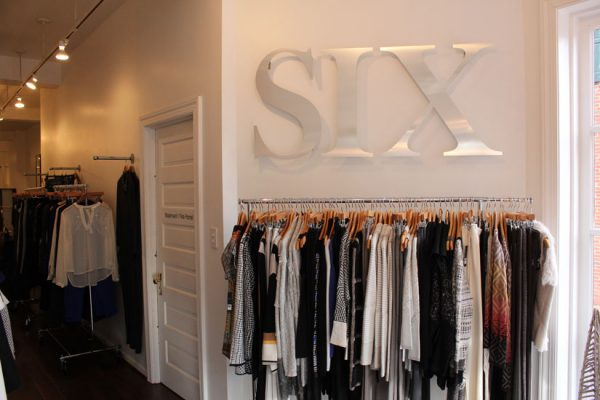 Six-on-East-Haddonfield-NJ-wall-display-logo-sign-clothes-on-racks