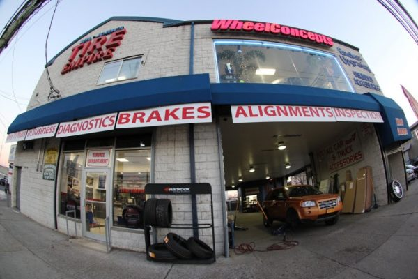 Wil Johns Tire Empire Staten Island NY tire dealer and auto repair shop store front entrance garage