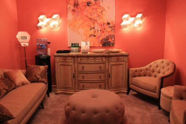 AquaSpa Day Spa and Nail Boutique Marlboro Morganville NJ fancy red waiting room sofa button tufted chair ottoman drawer