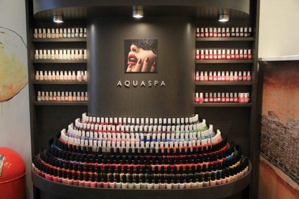 AquaSpa Day Spa and Nail Boutique Marlboro Morganville NJ opi nail polish display lips mouth