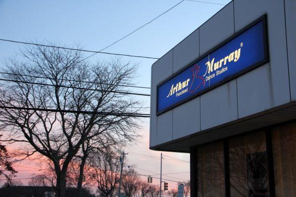 Arthur Murray Dance Studio Merrick NY sunset tree branches store front sign
