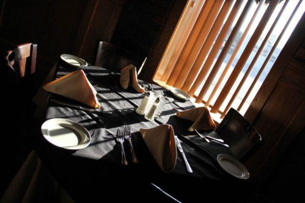 Neil Michaels Steakhouse Atlantic Highlands NJ table seating chiaroscuro lighting