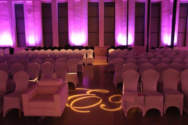 Skybox Productions Philadelphia PA event venue purple lighting seats covered chairs spotlight