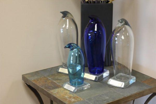 Crane Communications Inc Bala Cynwyd PA marketing award glass penguins