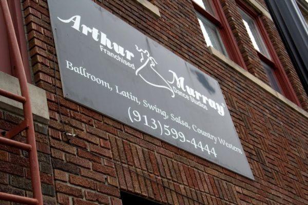 Arthur Murray Dance Studio Lenexa KS store front sign brick wall