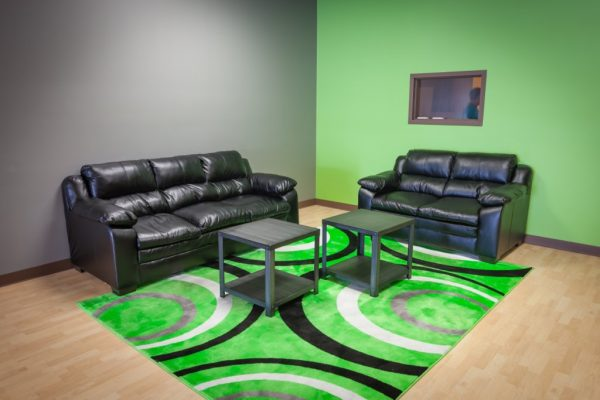 Club Vape Hebron KY green room rug black leather couches