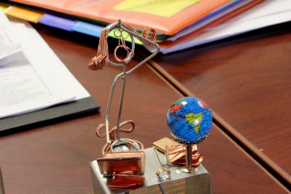 MCA Travel Inc Cherry Hill NJ wire sculpture exasperation at office desk