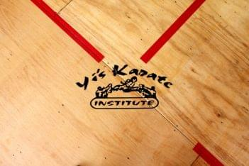 Yi's Karate of Cherry Hill NJ dojo wood floor logo