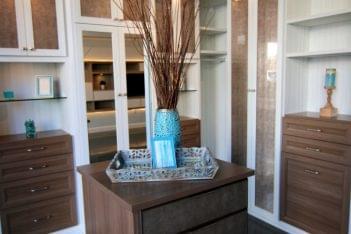 California Closets Los Altos CA interior design closet organization blue vase dresser