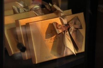 Horse Feathers Floral Design Mt Holly NJ gold godiva box of chocolate bow