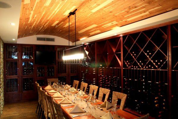 Restaurante Moriviví Cagaus, Puerto Rico Caribbean Restaurant wine cellar dining table