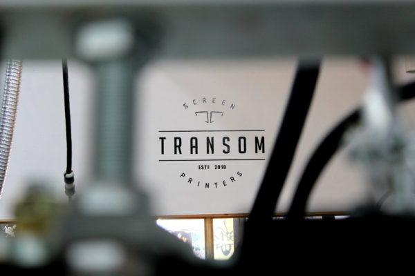 Transom T-shirts Prints & Designs Screen Printer San Juan, Puerto Rico logo