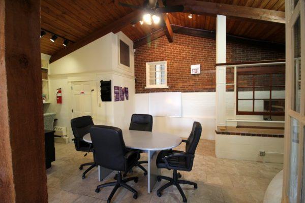 Keller Williams Realty Moorestown NJ meeting table exposed brick