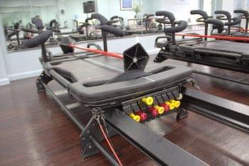 Coastal Core Fitness Pilates Studio Belmar NJ logo excercise machine