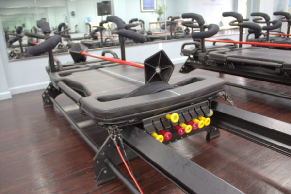 Coastal Core Fitness Pilates Studio Belmar NJ logo excercise machine