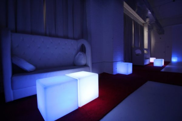 Walnut Loft Uptown Rec Room Bronx NY dark lights white couch