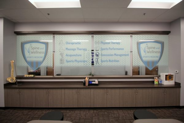 NJ Spine and Wellness Freehold, NJ Physical Therapy Clinic glass decal sign