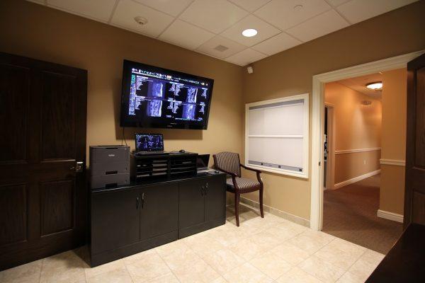 Q Spine Institute Paramus, NJ Orthopedic Surgeon Office Fish Aquarium Consultation room and xrays