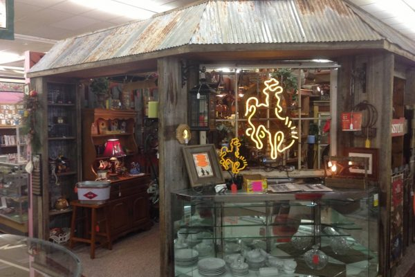 The Bent & Rusty Cotton Co. Laramie, WY Antique Furniture Store neon cowboy bucking horse