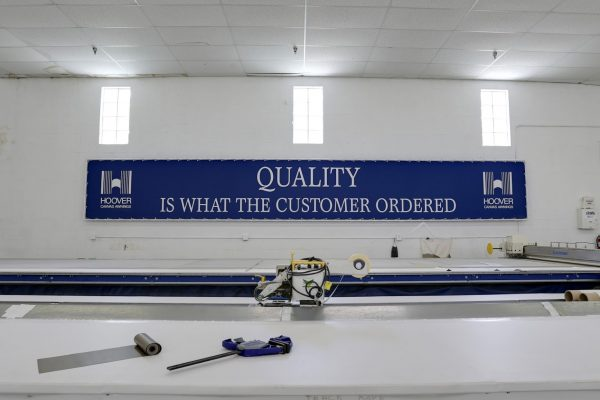 Blue sign in Hoover Architectural Products and canvas awnings in west palm beach florida