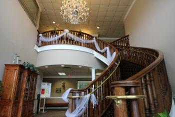 Marco's Restaurant & Banquets entrance curved staircase