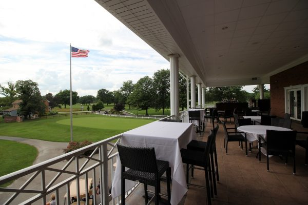 Marco's Restaurant & Banquets outdoor balcony view over Indian Spring golf course and American flag