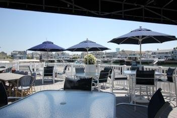 Yacht Club of Stone Harbor NJ pier patio tables