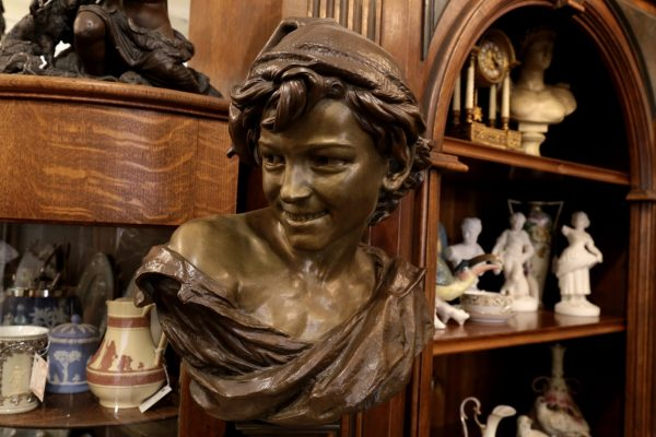 A Galerie Alexandria, VA Antique Store bronze bust of boy