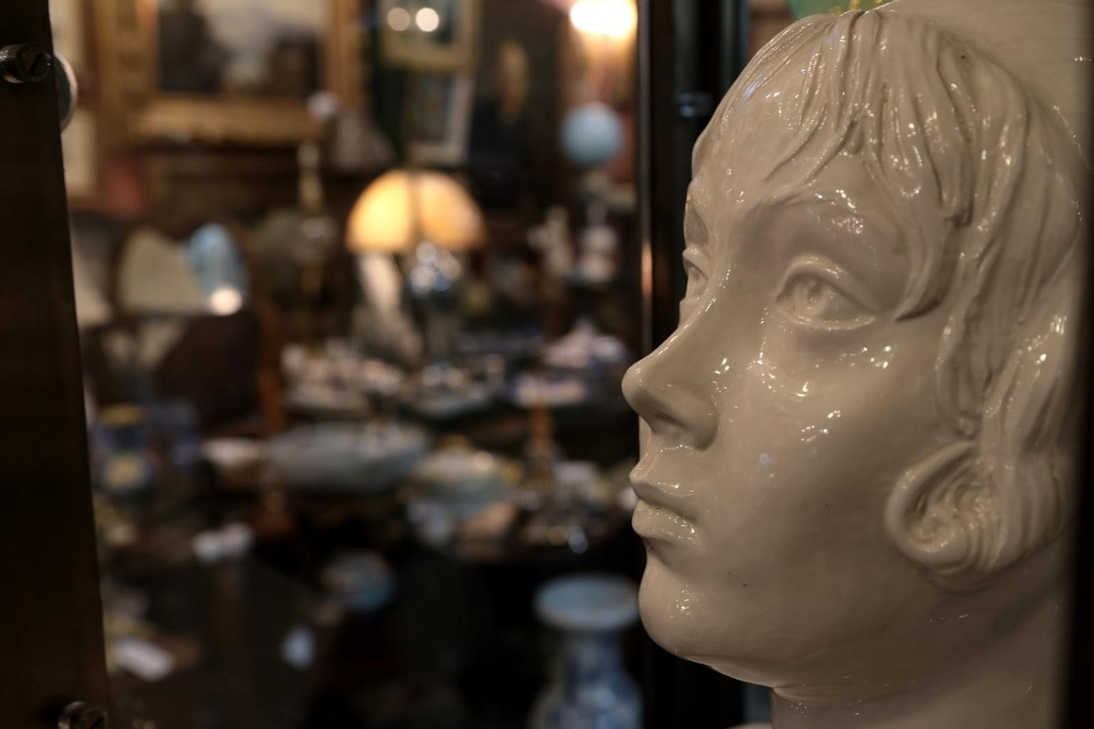 A Galerie Alexandria, VA Antique Store porcelain bust of girl