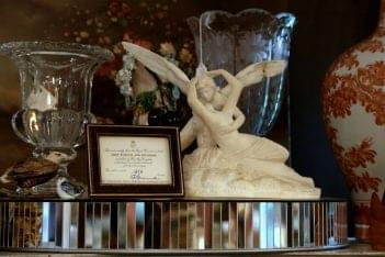A Galerie Alexandria, VA Antique Store psyche by cupid's kiss statue
