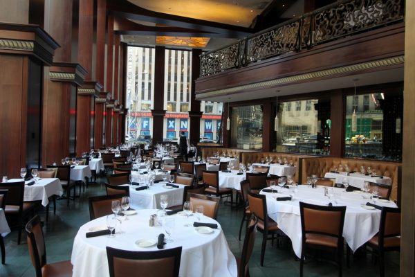 Del Frisco's Double Eagle Steak House in New York City table seating in dining hall