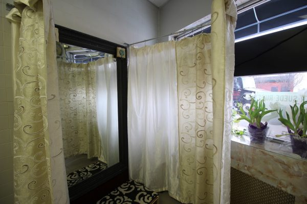 G&G Cleaners in Philadelphia, PA alteration fitting room curtain and mirror