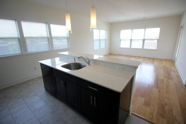 The Collings at The Lumberyard Apartment Complex in Collingswood, NJ kitchen island and living room