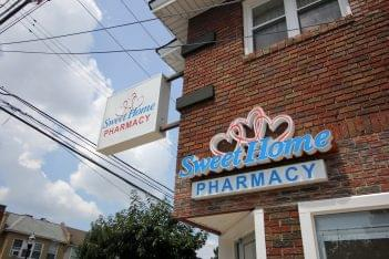 Sweet Home Pharmacy in Yeadon, PA brick exterior signs