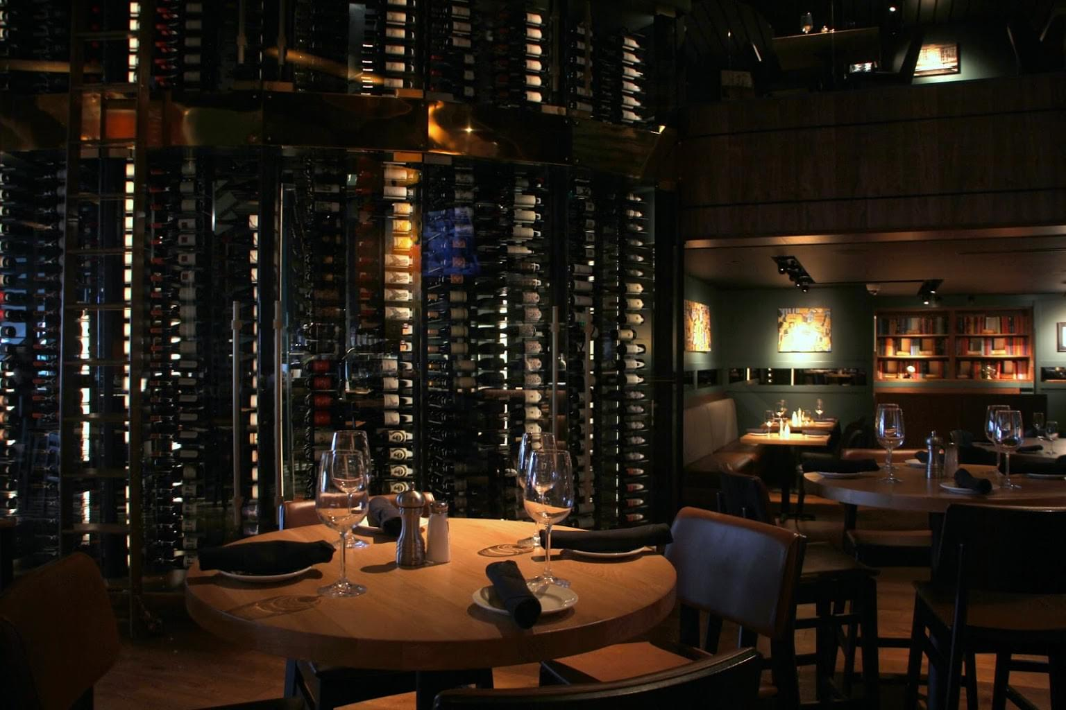 Del Frisco's Grille steak house in Philadelphia, PA dining table with wall of wines