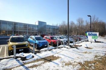 Holman GO Car dealership in Princeton, NJ store front car lot sign