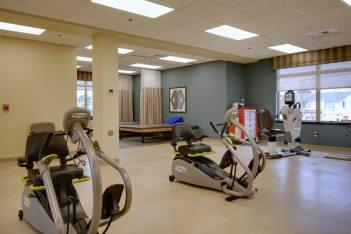 Mission Healthcare at Renton, WA rehabilitation center physical therapy room excercise machines nustep recumbent cross trainer