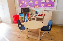 cardboard pizza over dining set at Lightbridge Academy pre-school and daycare in Manalapan, NJ
