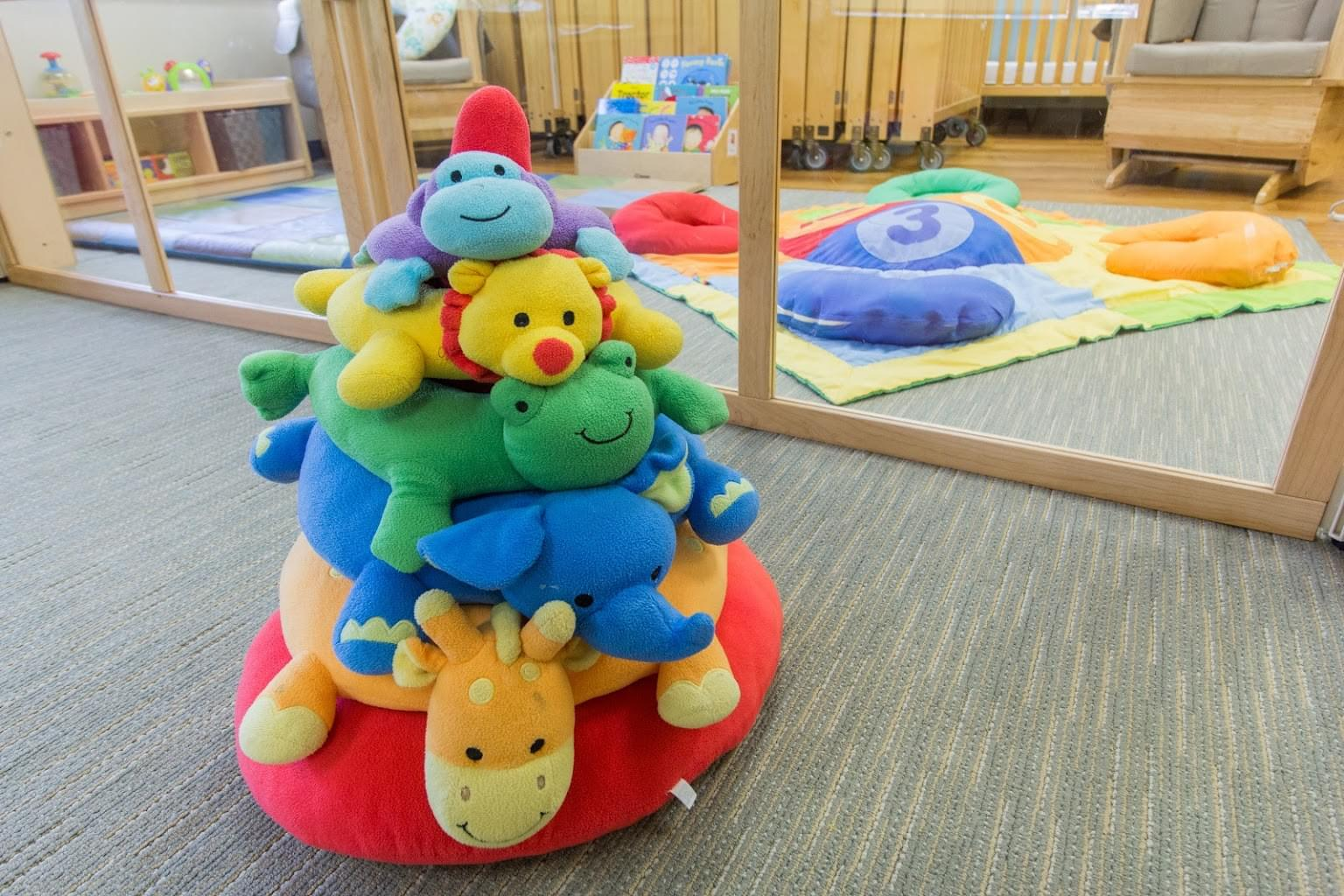 stack of doll in infant room of Lightbridge Academy pre-school and daycare in Rutherford, NJ