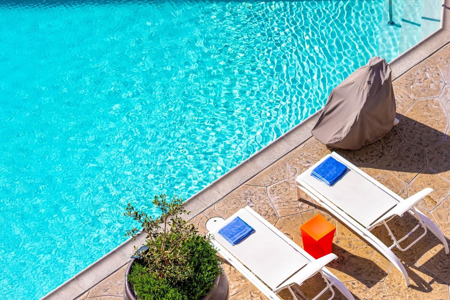 pool-side at Beach Terrace Inn beach-side hotel in Carlsbad, CA