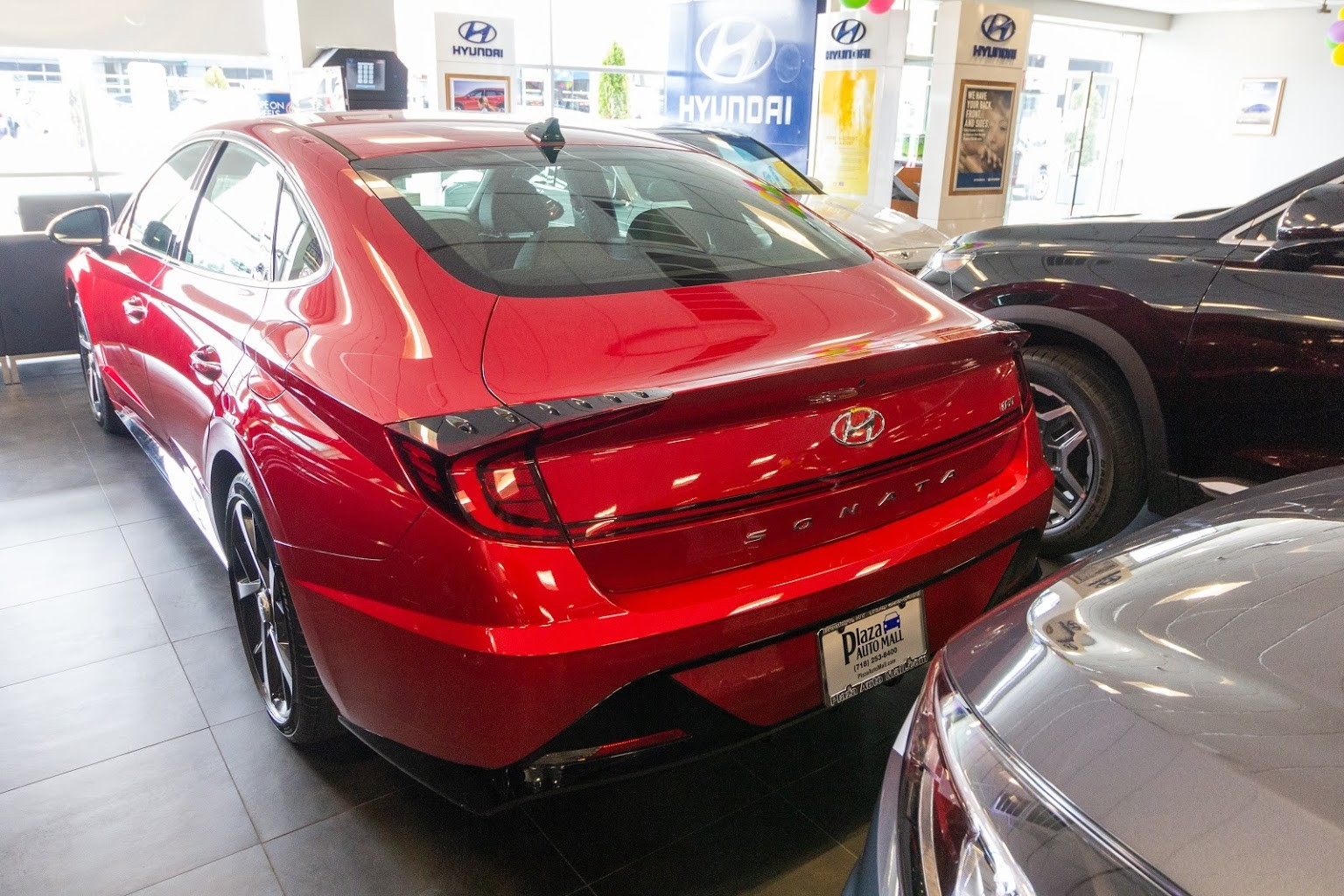 rear of red sonata Plaza Hyundai Car dealer in Brooklyn, NY
