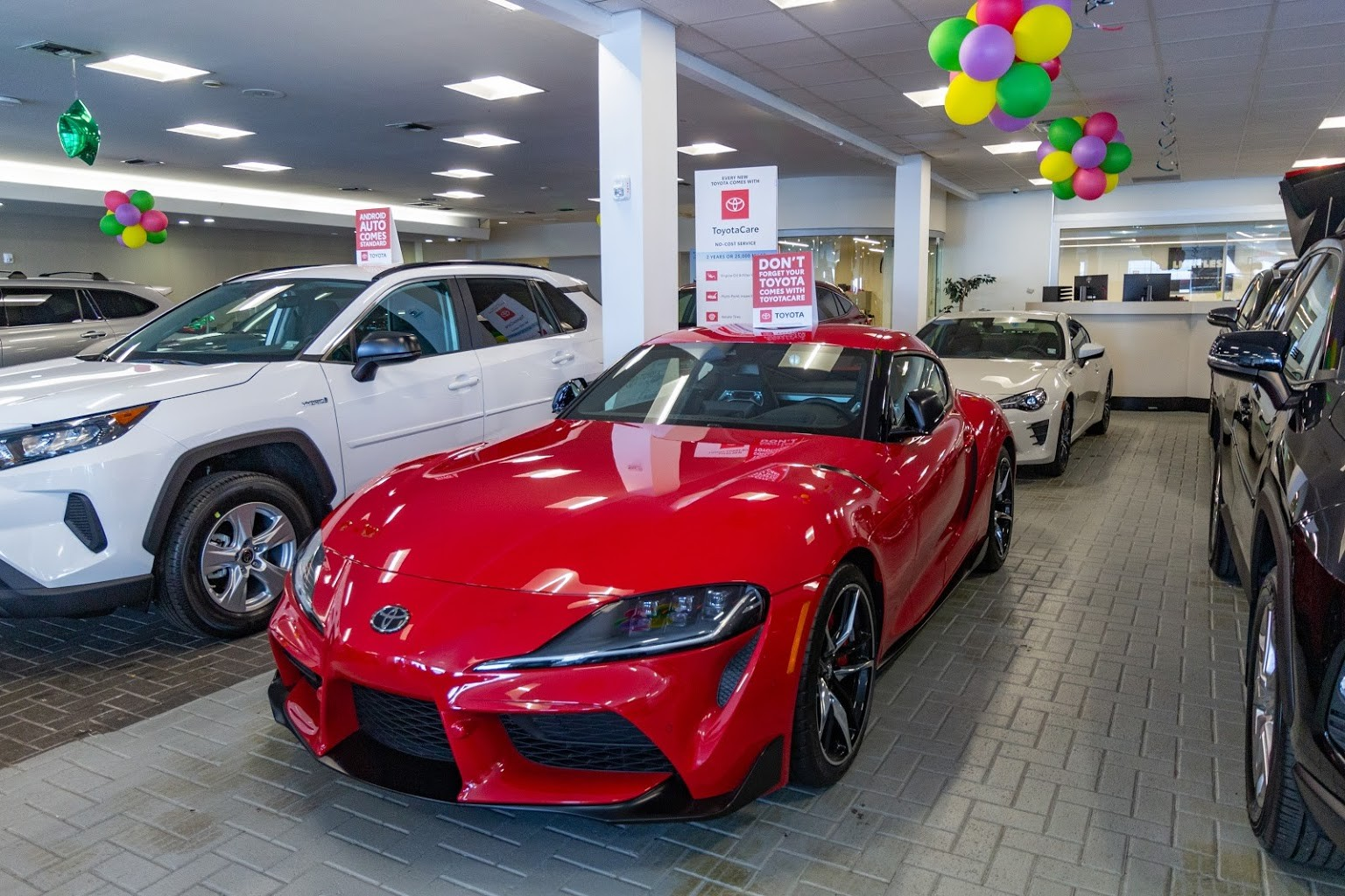 red supra front Plaza Toyota Car Dealership in Brooklyn, NY